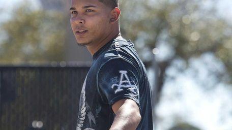 Ruben Tejada arrives at spring training on Sunday,