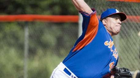 Bartolo Colon throws a bullpen session during spring