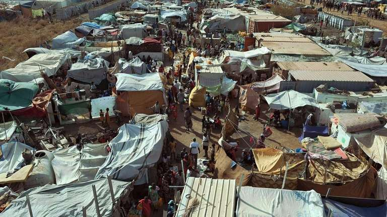 Internally displaced people stay inside a camp at