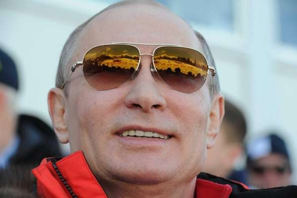 Russian president Vladimir Putin watches the men's cross-country
