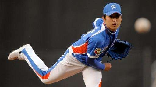 South Korea's pitcher Yoon Suk-min throws the ball