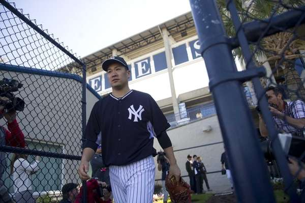 Yankees pitcher Masahiro Tanaka takes the field to