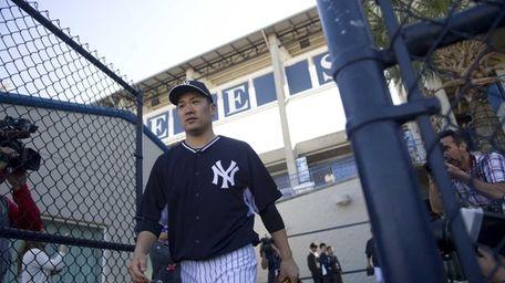 Yankees pitcher Masahiro Tanaka takes the field to