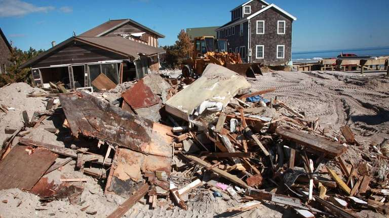 Debris from a demolished home is seen on
