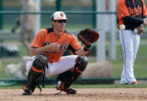 Baltimore Orioles catcher Taylor Teagarden catches the ball