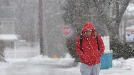 Luis Arias, of Patchogue, walks along Nottingham Avenue