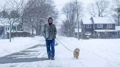 Andrew McGowan of Cutchogue takes his dog Ruffles