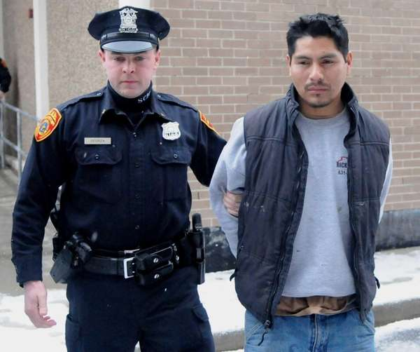 Luis Lucero Fajardo, 32, of Patchogue, walks Tuesday,