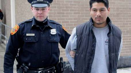 Luis Lucero Fajardo, 32, of Patchogue, walks Tuesday,