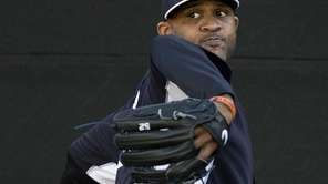 Yankees pitcher C.C. Sabathia throws in the bullpen