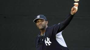Yankees pitcher CC Sabathia throws in the bullpen