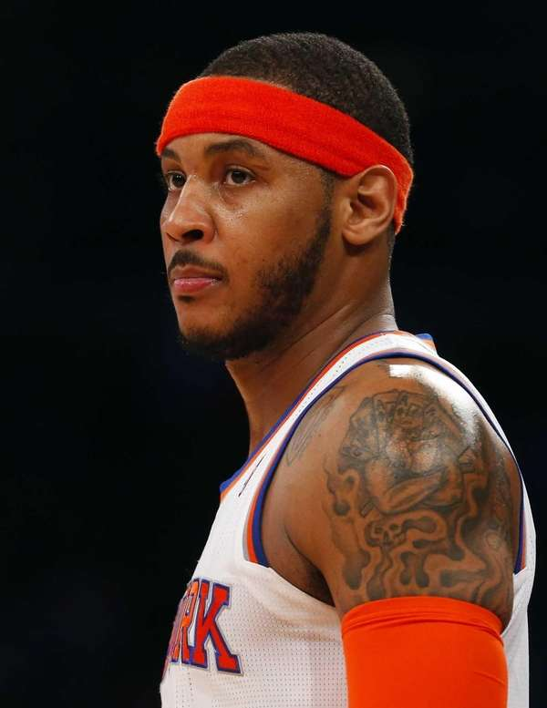 Carmelo Anthony looks on during a game against
