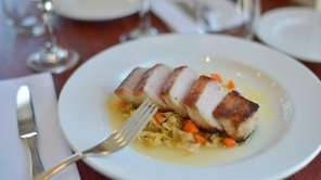 Tenderloin of pork is paired with apple-braised cabbage