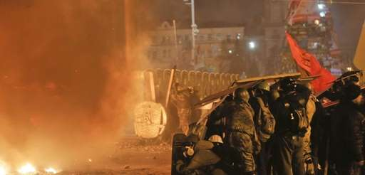 Anti-government protesters clash with riot police in Kiev's