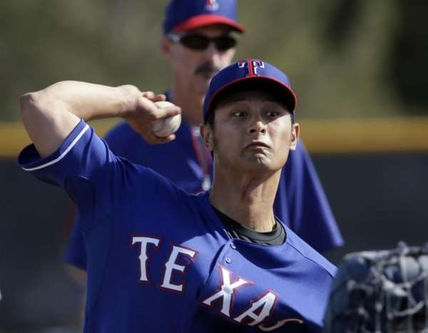 Texas Rangers' Yu Darvish, of Japan, throws batting