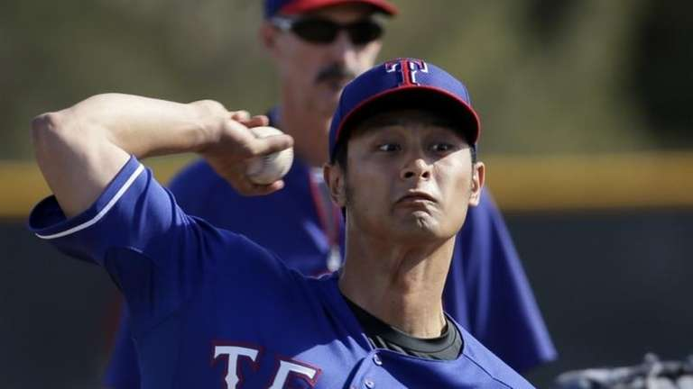 Texas Rangers' Yu Darvish, of Japan, throws batting