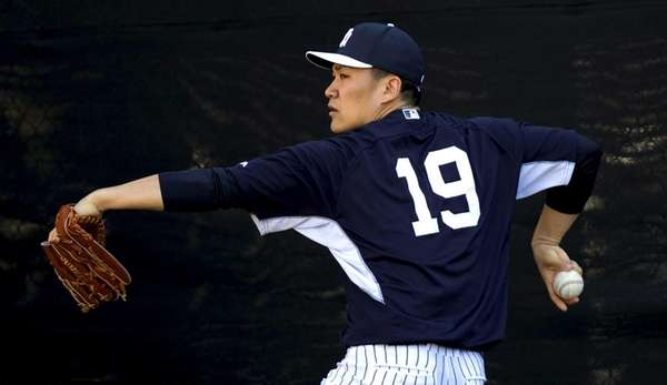 Yankees pitcher Masahiro Tanaka throws in the bullpen