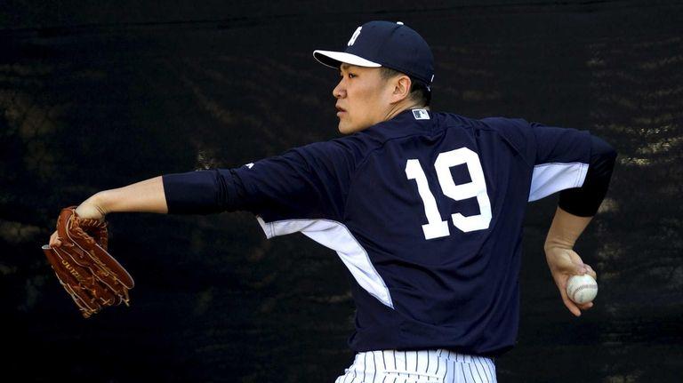 Yankees pitcher Masahiro Tanaka throws in the bullpen