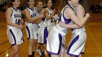 Hampton Bays basketball players celebrate after their victory