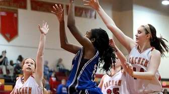 Copiague's Mikaiya Moore puts in the shot past