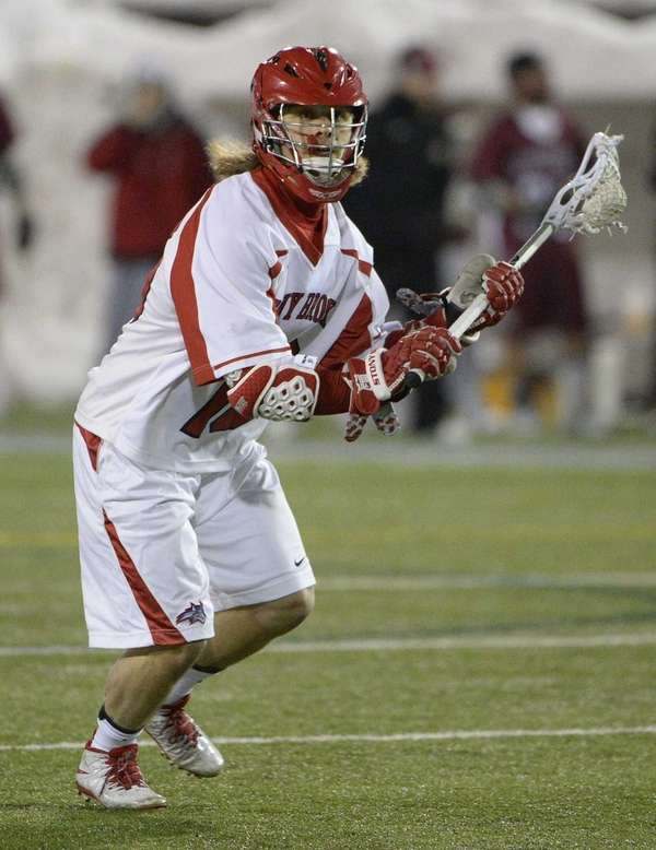 Stony Brook attacker Brody Eastwood looks to pass