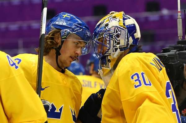 Carl Hagelin, left, and Henrik Lundqvist of Sweden