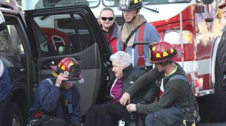 Maple Pointe resident Evelyn McAteer is evacuated on