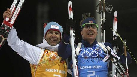 Norway's Ole Einar Bjoerndalen, left, and Emil Hegle