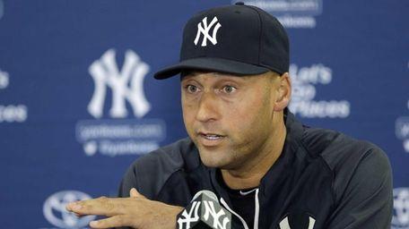 Yankees shortstop Derek Jeter gestures during a news