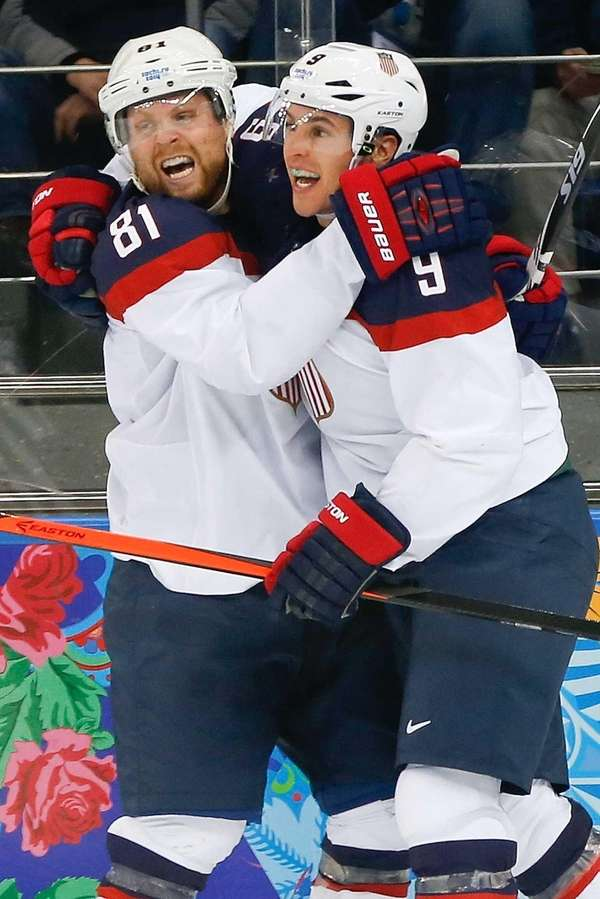 USA forward Zach Parise (9) celebrates his goal