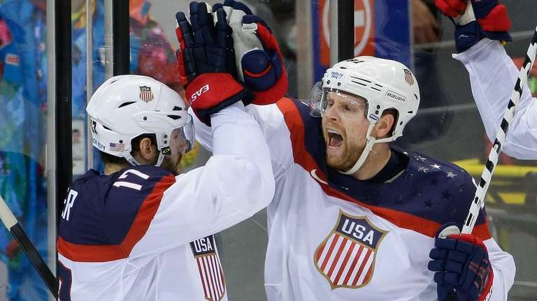 USA forward Phil Kessel, right, reacts to his