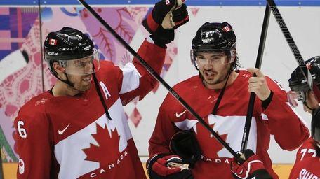 Canada defenseman Shea Weber, left, and Canada defenseman