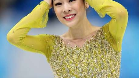 Yuna Kim of South Korea reacts after competing