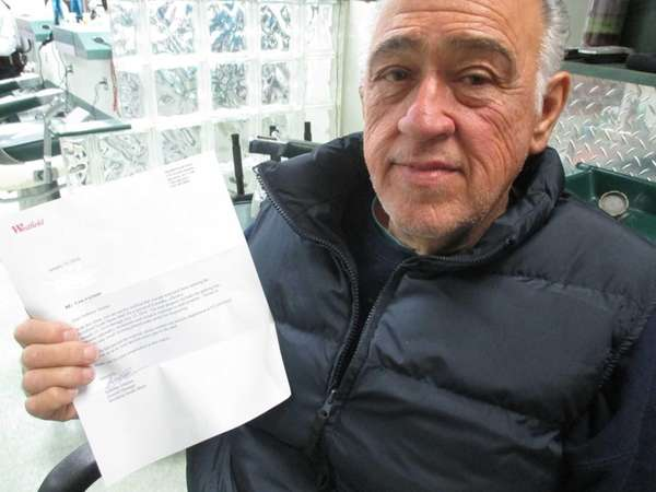 Anthony Arcese holds a letter banning him from