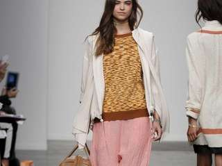 Karen Walker's spring-ready pants ($350), print sweater ($205)
