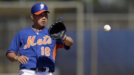 Mets pitcher Daisuke Matsuzaka catches a ball during