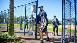Derek Jeter leaves after a press conference at