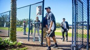 Derek Jeter leaves after a press conference at
