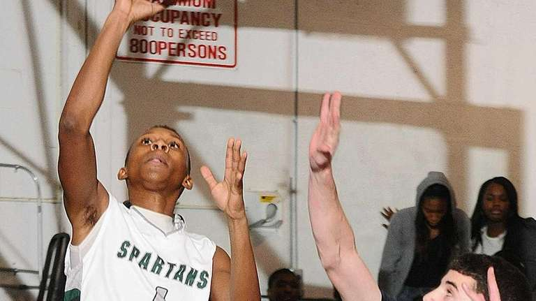 Elmont's Keith Tompkins looks to drive past Massapequa's