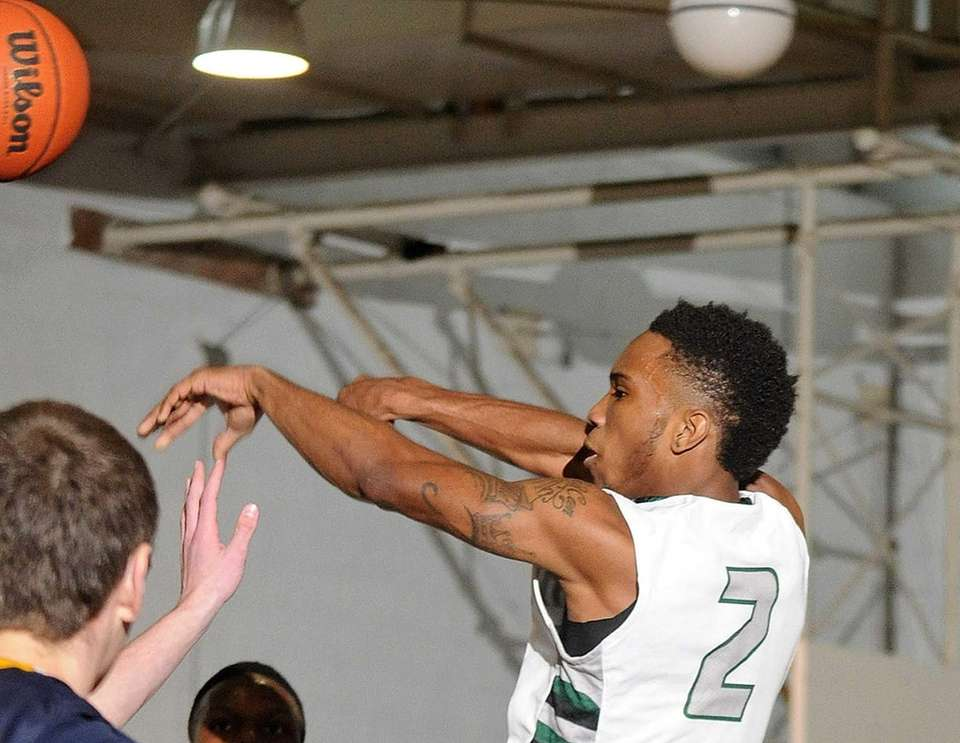 Elmont's Tristan Brown makes a pass during the