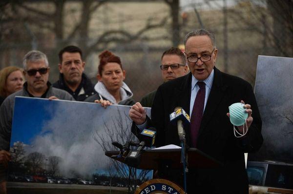U.S. Senator Charles E. Schumer speaks holding an