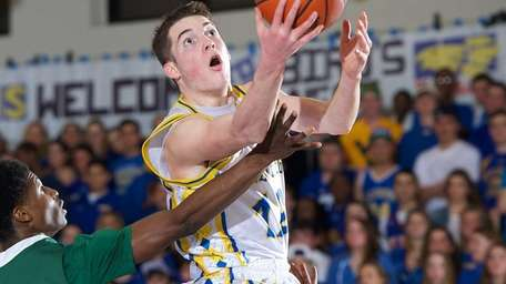 Kellenberg's Kyle Quinn drives to the basket in