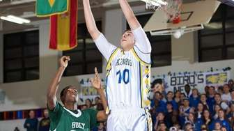 Holy Trinity's Bradley Eurene loses a rebound opportunity