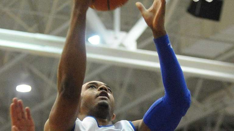 Hofstra's Zeke Upshaw drives to the hoop for