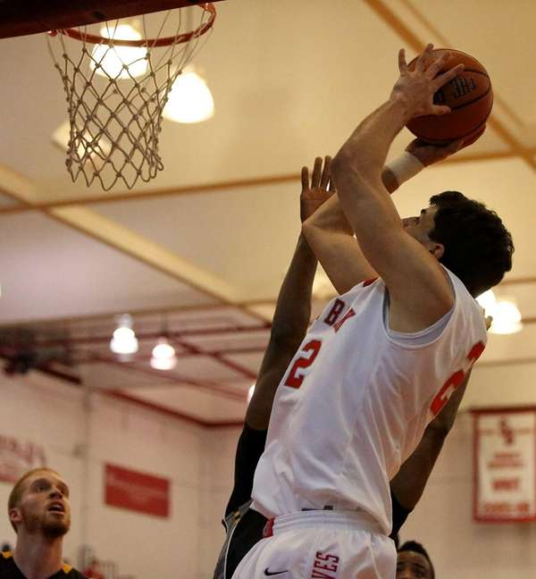 Stony Brook's Eric McAlister goes for the dunk
