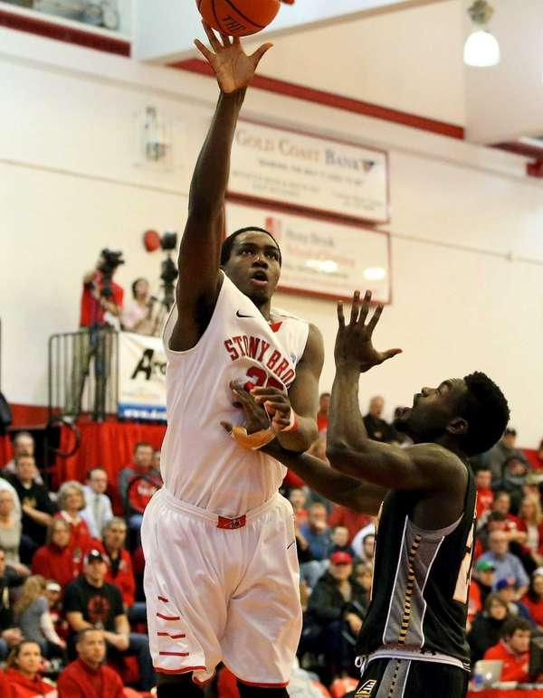 Stony Brook's Jameel Warney shoots the one handed