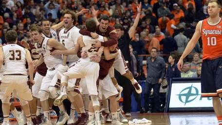 Boston College players celebrate after defeating Syracuse 62-59