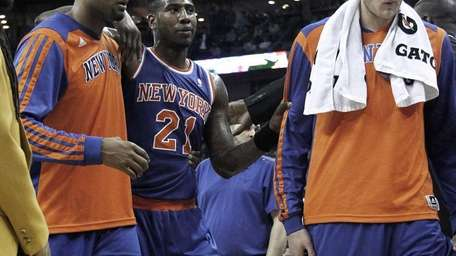 Iman Shumpert is helped off the court after