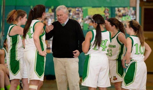 Seaford girls basketball team huddles with coach Bob