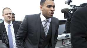 Chris Brown, right, arrives at the District of